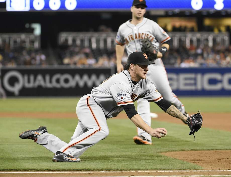Jake Peavy #22 of the San Francisco Giants dives onto first base to get the out on Derek Norris of the San Diego Padres during the fouth inning of a baseball game at Petco Park September 23, 2015 in San Diego, California. Photo: Denis Poroy, Getty Images