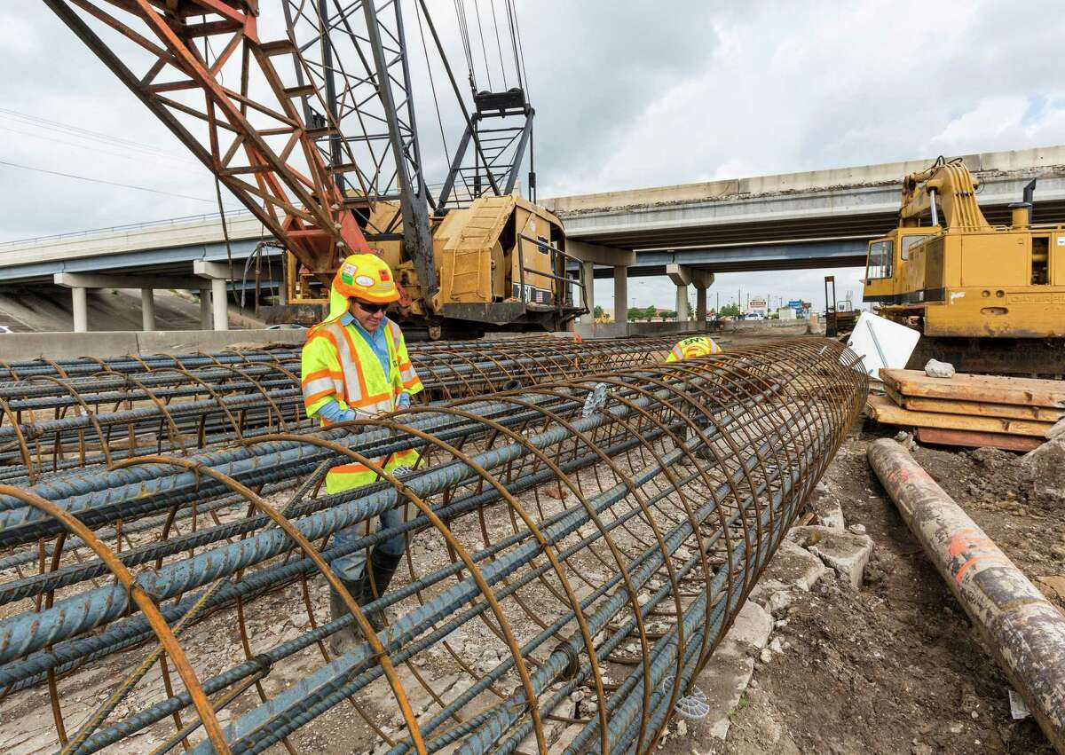 Gerson R. Chavez works stringing steel for a highway support column beside the northbound lane of Interstate 45 just south of El Dorado on May 5, 2015.