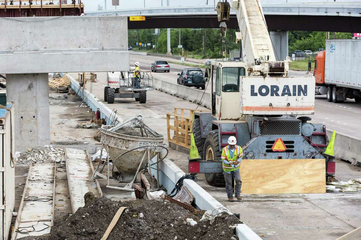 Traffic whizzes along the northbound lane of Interstate 45 as construction work proceeds on the HOV lane near Dixie Farm Road on May 5, 2015.