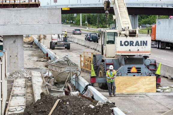 TxDOT is working on widening sections of I-45 south of downtown, especially around NASA Road 1 and Clear Lake. ID: Traffic whizzes along the northbound lane of I45 as construction work proceeds on the HOV lane near Dixie Farm Road. Tuesday  May 5, 2015