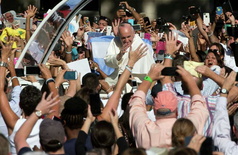 Pope Francis arrives in the popemobile at the Basilica of the National Shrine of the Immaculate Conception in Washington, Wednesday, Sept. 23, 2015, for the Canonization Mass for Junipero Serra. (AP Photo/Alessandra Tarantino) Photo: Alessandra Tarantino, STF / Associated Press / AP