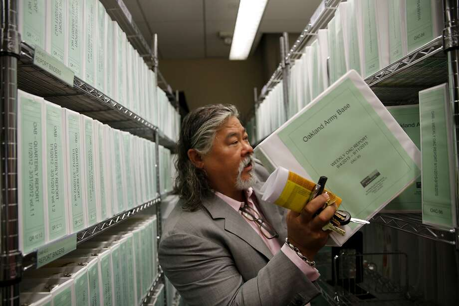 Phil Tagami at his company's offices surrounded by reports on the Oakland Army Base project in Oakland, California, on Wednesday, Sept. 23, 2015. Photo: Connor Radnovich, The Chronicle