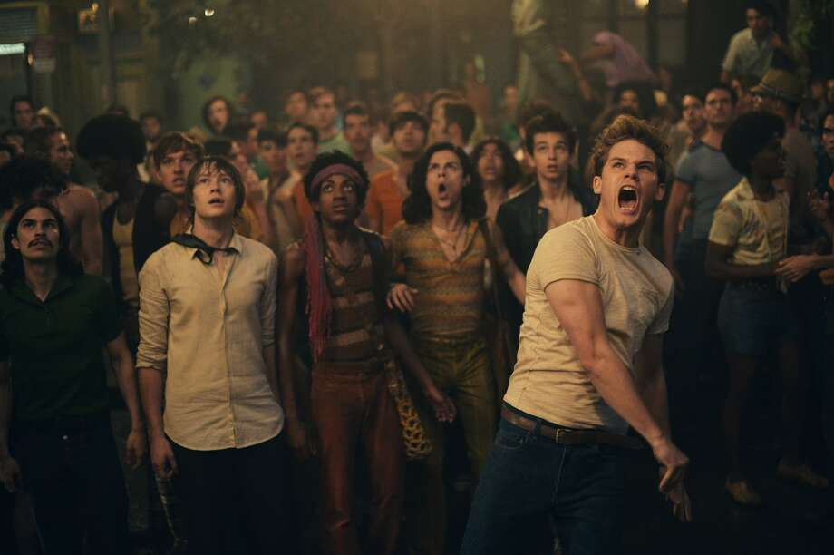 """Jeremy Irvine as Danny (foreground) and the cast of """"Stonewall."""" Roland Emmerich's dramatization of the 1969 Stonewall riots, scripted by Jon Robin Baitz, opens Friday, September 25, at Bay Area theaters.  Photo by Philippe BossŽ / Courtesy of Roadside Attractions Photo: Philippe BossŽ / Courtesy Of Roa / ONLINE_YES"""