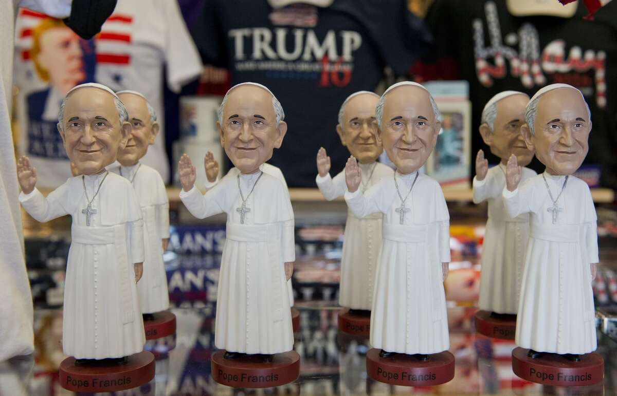 Pope Francis bobble heads are displayed at a souvenir store in Washington, DC on August 27, 2015. Pope Francis will travel to the United States from September 22-27, stopping in Washington, DC, New York, and Philadelphia