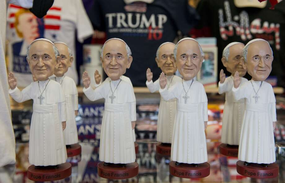 Pope Francis bobble heads are displayed at a souvenir store in Washington, DC on August 27, 2015. Pope Francis will travel to the United States from September 22-27, stopping in Washington, DC, New York, and Philadelphia Photo: Andrew Caballero-Reynolds/AFP/Getty