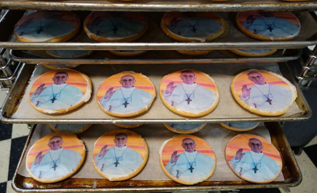 Cookies with the Pope Francis' image on them are sold at Artuso's Pastry on September 23, 2015 in New York. Artuso's Pastry recently received a single order for 10,000 cookies in Florida, adding to the 20,000 they're already fulfilling ahead of the Pope's visit to New York City.