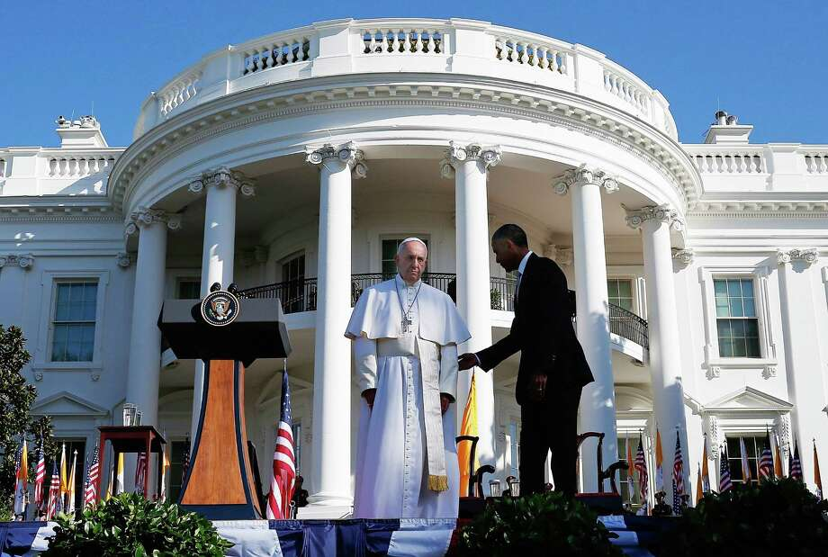 President Barack Obama welcomes Pope Francis during an arrival ceremony at the White House on Wednesday. He devoted much of his remarks to climate change. Photo: Win McNamee / / 2015 Getty Images