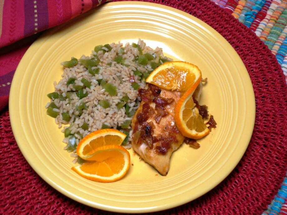 Chicken sauteed in a savory orange sauce is an unusual, tangy Mexican dish. Rice tossed with green peppers makes a simple side dish. (MCT) Photo: HANDOUT, MCT / MCT