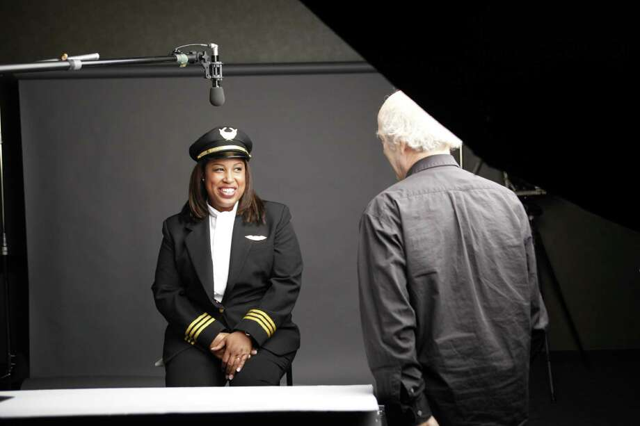 """Nia Wordlaw of Pearland travels the world as a commercial airline pilot.She's profiled in """"The Women's List."""" Photo: Tim Greenfield Sanders"""