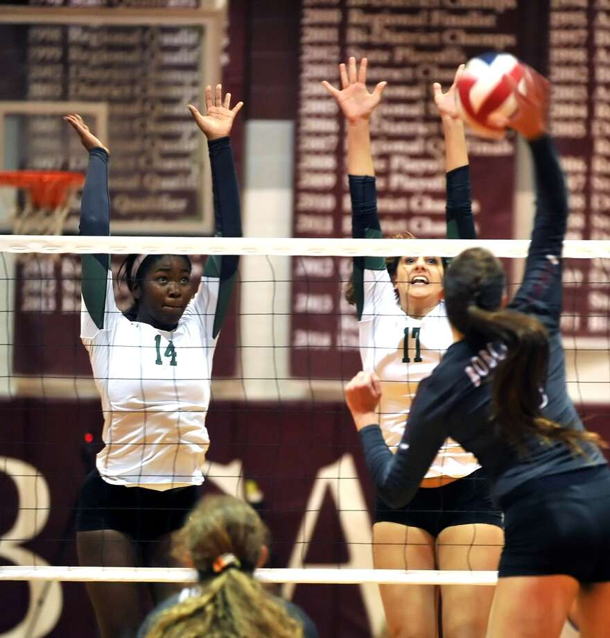Cy Falls volleyball team visited district rival Cy Fair for a game, 9-19-15.  Cy Falls won the match, 3-2.   Cy Falls' s net protectors are Lola Alaka (14) left, and Emily Waller (17). Photo: Eddy Matchette, Freelance / Freelance