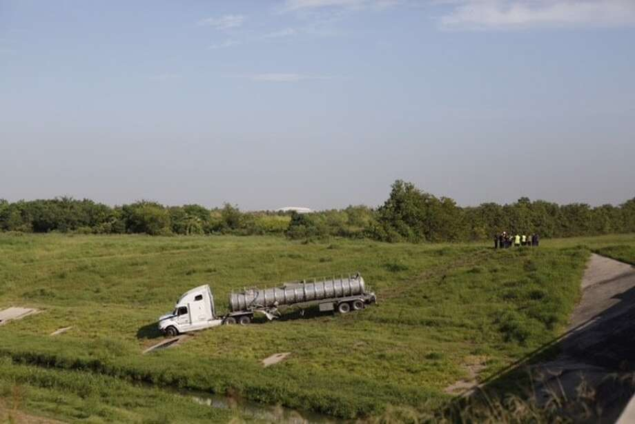 A big-rig tanker truck plunged into Sims Bayou along Highway 288 in south Houston in Thursday morning. Photo: Cody Duty