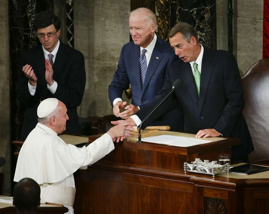 Pope Francis is greeted by House Speaker John Boehner of Ohio and Vice President Joe Biden on Capitol Hill in Washington, Thursday, Sept. 24, 2015, prior to the pope's address to a joint meeting of Congress, making history as the first pontiff to do so. (AP Photo/Pablo Martinez Monsivais) Photo: Pablo Martinez Monsivais, Associated Press