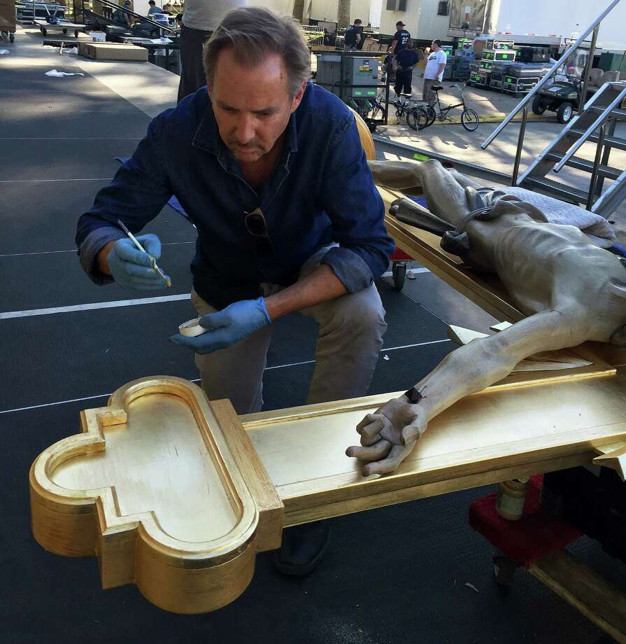 Westport artist Lawrence Hoy works on a large crucifix that will be displayed during a Mass celebrated by Pope Francis during his visit to Philadelphia. Photo: Contributed / Contributed Photo / Westport New
