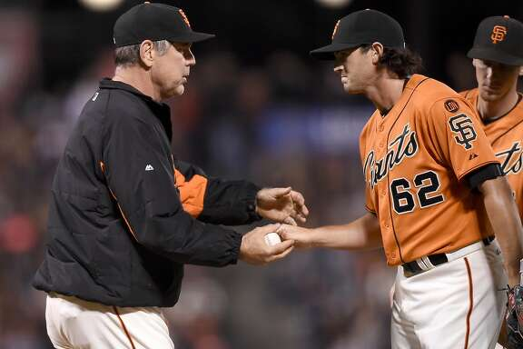 SAN FRANCISCO, CA - SEPTEMBER 18:  Manager Bruce Bochy #15 of the San Francisco Giants takes the ball from Cory Gearrin #62 taking out of the game against the Arizona Diamondbacks in the top of the ninth inning at AT&T Park on September 18, 2015 in San Francisco, California.  (Photo by Thearon W. Henderson/Getty Images)