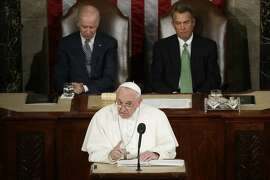 Pope Francis addresses a joint meeting of Congress on Capitol Hill in Washington, Thursday, Sept. 24, 2015, making history as the first pontiff to do so. Listening behind the pope are Vice President Joe Biden and House Speaker John Boehner of Ohio. (AP Photo/Pablo Martinez Monsivais)