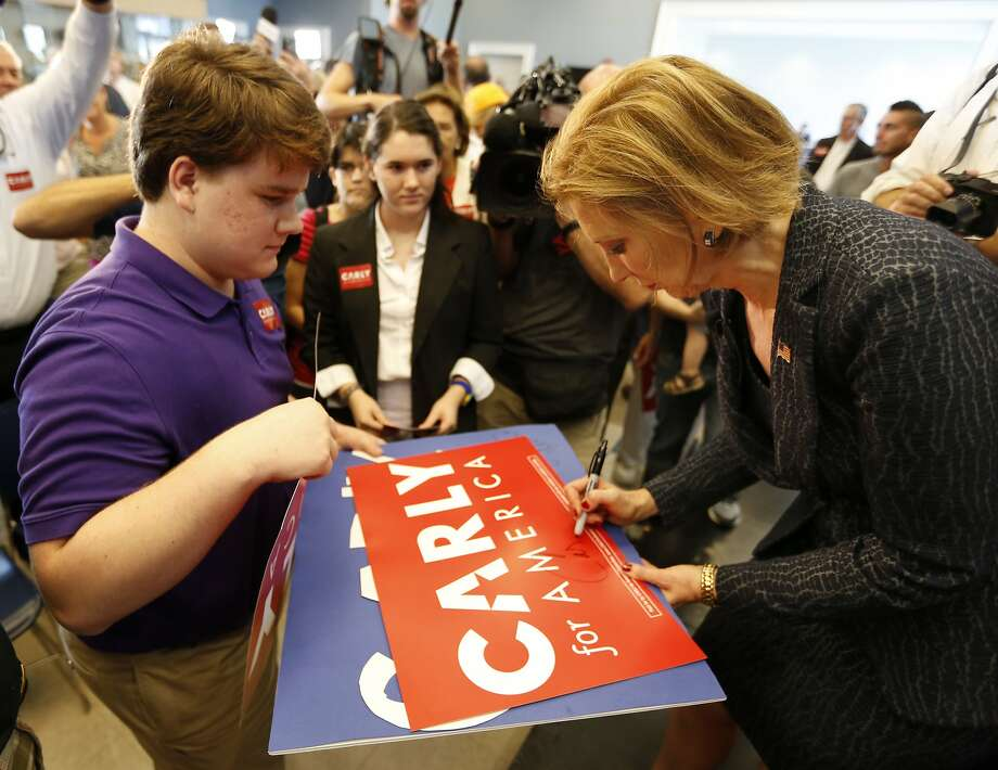 Republican presidential candidate, businesswoman Carly Fiorina, greets a supporter after speakng to South Carolina residents during a town hall meeting concerning foreign affairs at Johnson Hagood Stadium on the campus of The Citadel in Charleston, S.C., Tuesday, Sept. 22, 2015. (AP Photo/Mic Smith) Photo: Mic Smith, Associated Press