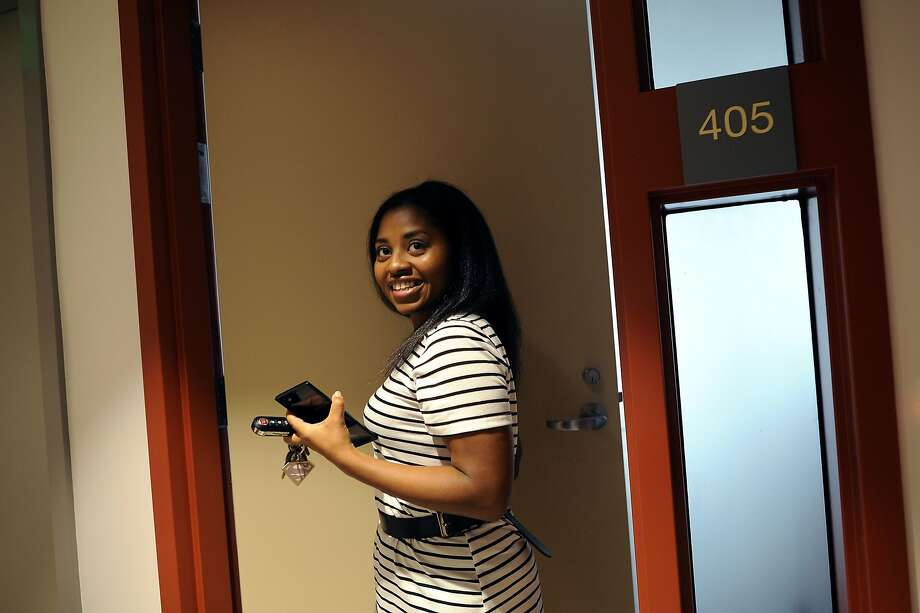 Shaquita Briellard smiles as she stands at the front door of the new two-bedroom apartment that she shares with her 10-year-old son, Dereon McKenzie, in the Beale Street Family Community affordable housing building, operated by Mercy Housing California, in San Francisco. Photo: Michael Short, Special To The Chronicle