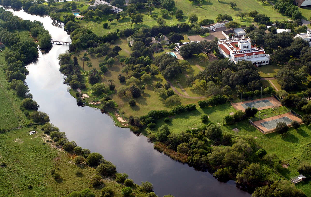 The King Ranch main house, seen Wednesday afternoon Sept. 24, 2003, sits next to Santa Gertrudis Creek. The regular supply of water was a major reason Capt. King chose the area for the ranch's headquarters. (WILLIAM LUTHER/STAFF)