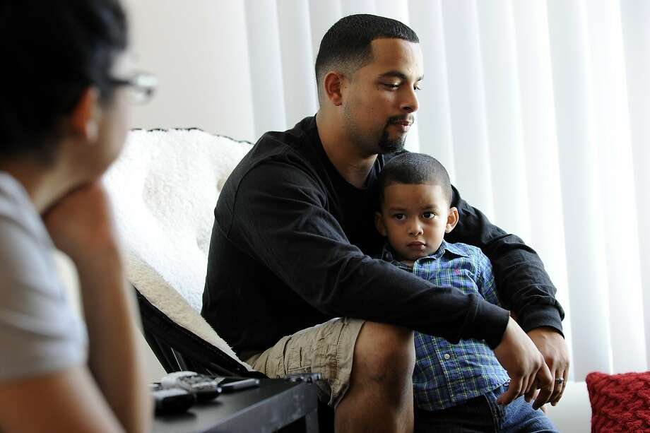 Julian Aleman holds his son Joshua, 2 1/2, while talking about his family's struggles to find housing as his finance Jessica Pascasio looks on as they sit in their new 2 bedroom apartment at the Beale Street Family Community, operated by Mercy Housing California, in San Francisco, CA Wednesday, September 23, 2015. Photo: Michael Short, Special To The Chronicle
