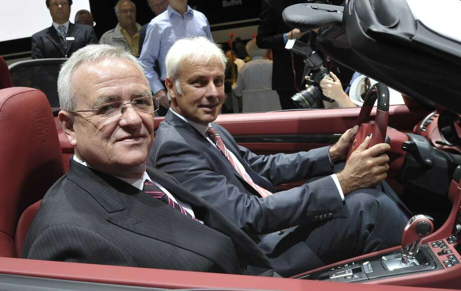 (FILES) This picture taken on June 25, 2012 shows Volkswagen AG CEO and Porsche Automobil Holding SE CEO Martin Winterkorn (front) and Porsche AG CEO Matthias Mueller pose with a Porsche 911 during the annual general meeting of Porsche Automobil Holding SE in Stuttgart, southern Germany. Mueller was designated on September 24 to replace CEO of Volkswagen Martin Winterkorn amid a pollution scandal.   AFP PHOTO/THOMAS KIENZLETHOMAS KIENZLE/AFP/Getty Images Photo: Thomas Kienzle, AFP / Getty Images