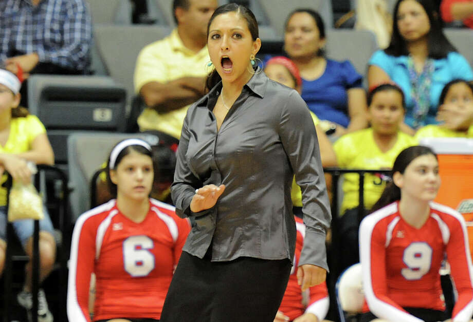 Antonian head volleyball coach Samantha McLure yells to her players on the court during the Antonian Apaches and Incarnate Word Shamrocks TAPPS 5A volleyball match at Greehey Arena in San Antonio on Oct. 19, 2011. Photo: Express-News File Photo / San Antonio Express-News