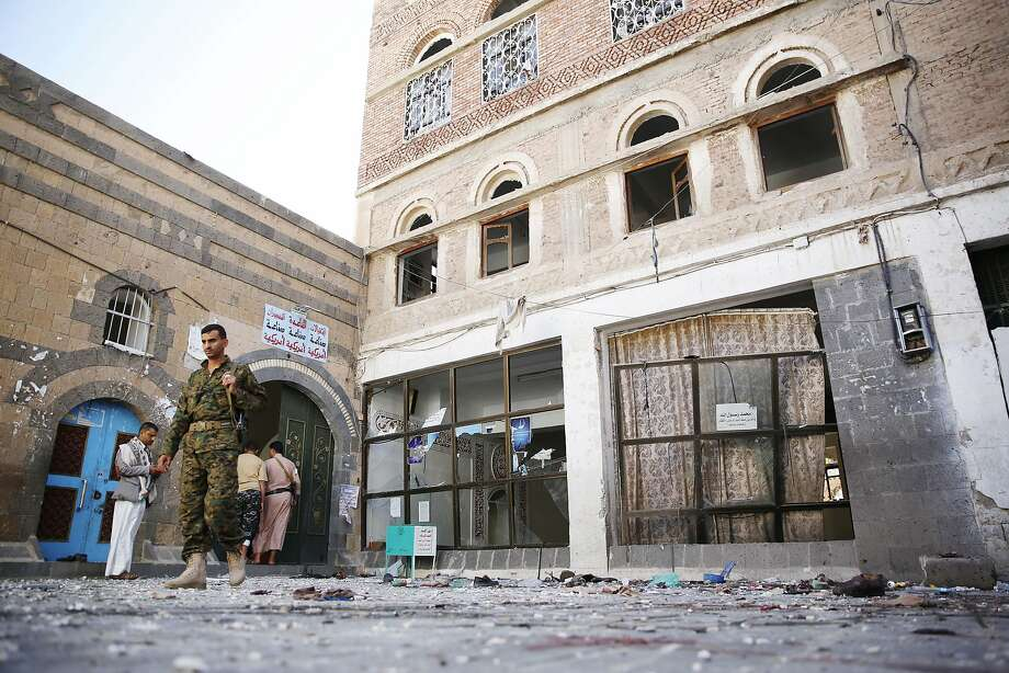 Houthi Shiite fighters inspect the scene after two suicide bombings at a mosque in the capital, Sanaa. Photo: Hani Mohammed, Associated Press