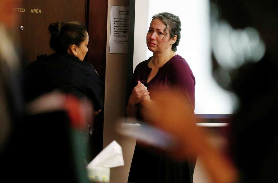 Closing arguments were held in Judge Sid Harle's courtroom where Bexar County prosecutors David Martin and Daniel Rodriguez are trying to seek one count of murder and one count of injury to an elderly individual against Rebecca Friese (pictured) at the Cadena-Reeves Justice Center on Thursday, Sept. 24, 2015. Friese's attorney Raymond Martinez argued to the jury that Friese was defending herself when she used a cooking pan to strike her 84-year-old mother, Lydia Friese, in the head at their apartment in March 2014. Lydia Friese lived for several weeks and passed away due to a pulmonary embolism or blood clot. Friese had plead not guilty on both indictments. Photo: Kin Man Hui, San Antonio Express-News / ©2015 San Antonio Express-News