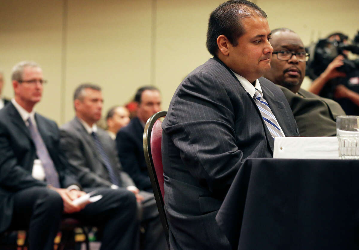 Jay coach Gary Gutierrez answers tough questions as the UIL State Executive Committee meets to discuss the Jay referee hit incident in a special meeting at the Austin Marriott North in Round Rock on September 24, 2015. To the side of the Mustang's coach is Jay principal Robert Harris, behind are Northside athletic director Stan Laing and Superintendant Brian Woods.