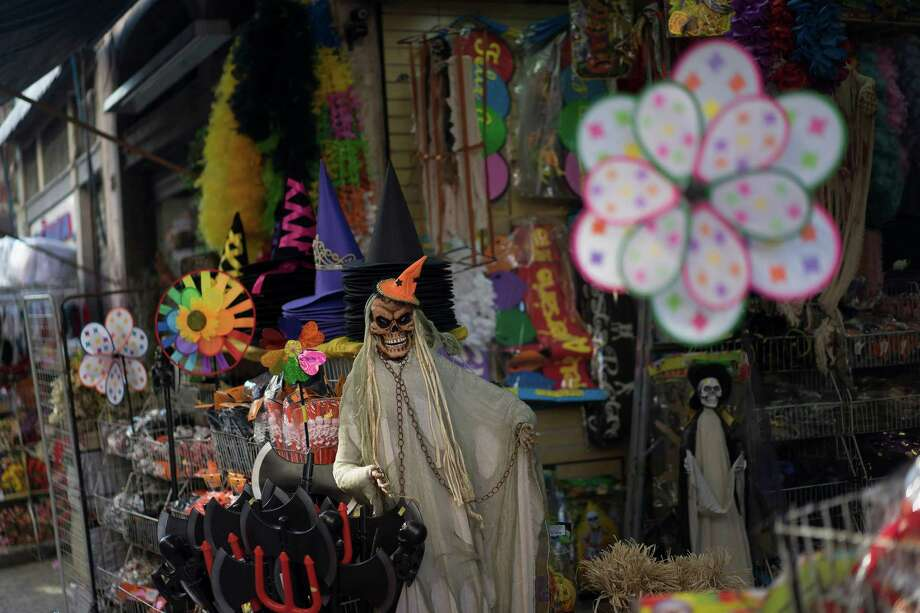 """In this Sept. 18, 2015 photo, Halloween products are displayed in the entrance of a store at the Saara street market in Rio de Janeiro, Brazil.  For visitors capable of prying themselves off Copacabana's golden sands, the neighborhood, known in Portuguese as """"Centro""""  is a fascinating detour.   (AP Photo/Leo Correa) Photo: Leo Correa, STR / AP"""
