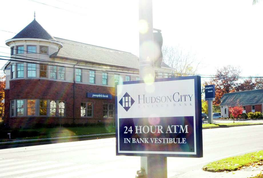 A Hudson City Savings Bank sign on Putnam Avenue in Greenwich. The bank was fined $5.5. million and ordered to grant $27 million in loans to minorities after it discriminated against black and Hispanic neighborhoods by denying fair access to mortgages, federal officials said on Thursday. Photo: File Photo / Greenwich Time