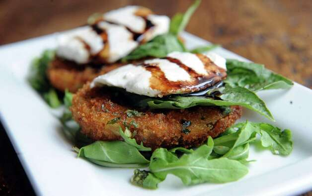 Fried green tomatoes caprese salad at the Twisted Vine Wine & Tap on Tuesday Sept. 22, 2015 in Delmar, N.Y.  (Michael P. Farrell/Times Union) Photo: Michael P. Farrell / 00033445A