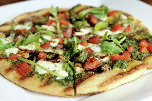 Bruschetta flatbread at the Twisted Vine Wine & Tap on Tuesday Sept. 22, 2015 in Delmar, N.Y.  (Michael P. Farrell/Times Union) Photo: Michael P. Farrell / 00033445A
