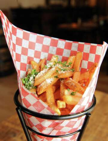 Truffle oil french fries at the Twisted Vine Wine & Tap on Tuesday Sept. 22, 2015 in Delmar, N.Y.  (Michael P. Farrell/Times Union) Photo: Michael P. Farrell / 00033445A