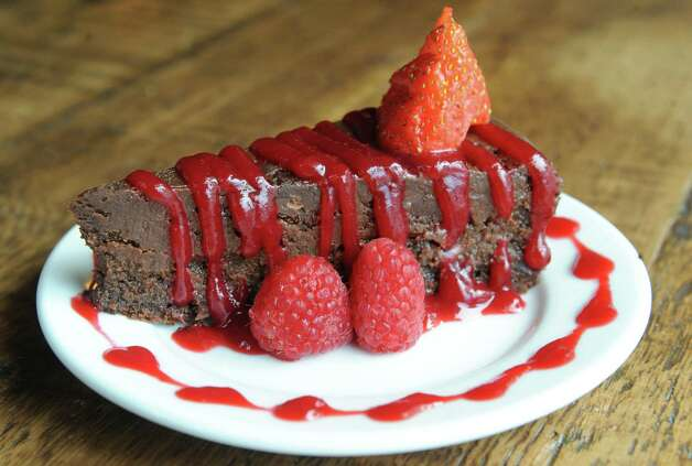Chocolate flour less cake with raspberry sauce at the Twisted Vine Wine & Tap on Tuesday Sept. 22, 2015 in Delmar, N.Y.  (Michael P. Farrell/Times Union) Photo: Michael P. Farrell / 00033445A