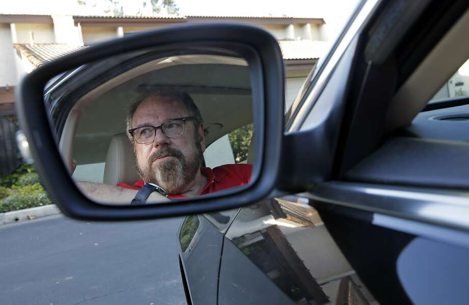 Bob Rand poses for a photo in his 2014, fully loaded Volkswagen diesel Passat on Wednesday, Sept. 23, 2015, in Pasadena, Calif. Rand convinced his son and his friend to buy the same car for environmental reasons. Now he's trying to sell it. (AP Photo/Chris Carlson) Photo: Chris Carlson, Associated Press