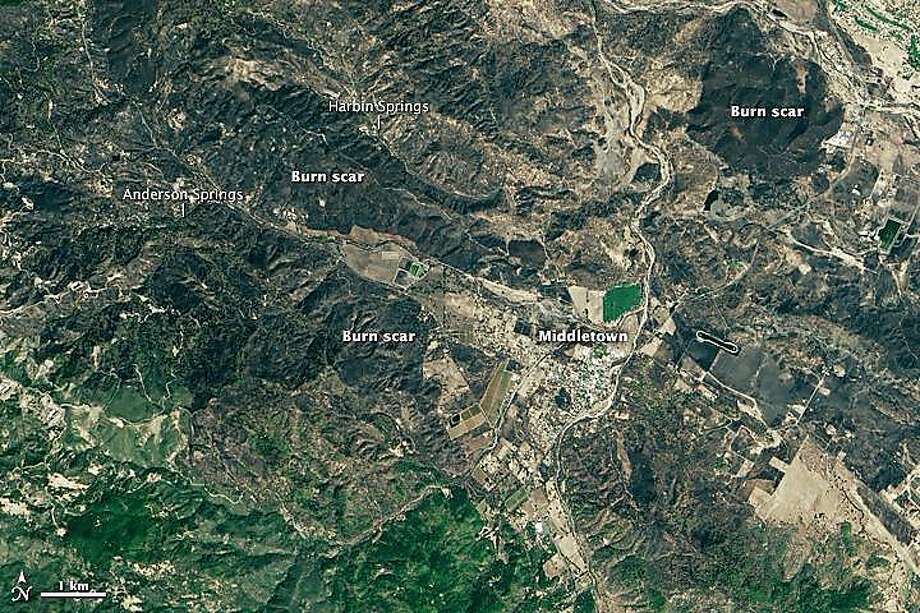 Images captured by NASA's Landsat 8 satellite show the massive burn area of the Valley Fire that burned through Lake County and started on Sept. 12. Photo: NASA
