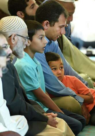 Young and old worshipers take part in the Eid Ul Adha, festival following hajj Thursday morning Sept. 24, 2015 at the Al-Hidaya Center in Latham, N.Y.    (Skip Dickstein/Times Union) Photo: SKIP DICKSTEIN / 00033467A