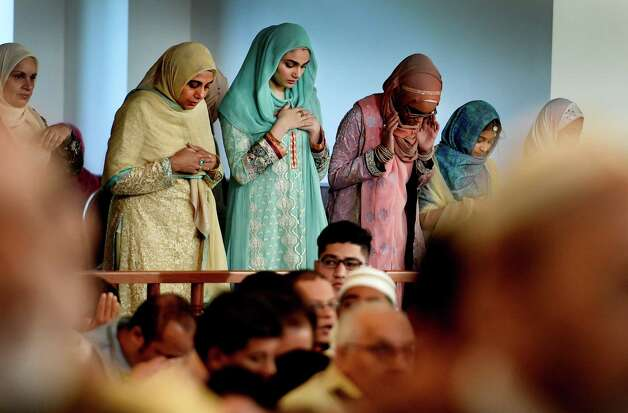 Worshipers take part in the Eid Ul Adha, festival following hajj Thursday morning Sept. 24, 2015 at the Al-Hidaya Center in Latham, N.Y.    (Skip Dickstein/Times Union) Photo: SKIP DICKSTEIN / 00033467A