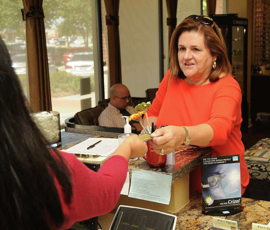 Kay Gutowsky uses her EMV card to pay for glasses at Eye Trends-Barker Cypress on Saturday Sept. 19,2015.(Dave Rossman photo) Photo: Dave Rossman, Freelance / Freelalnce