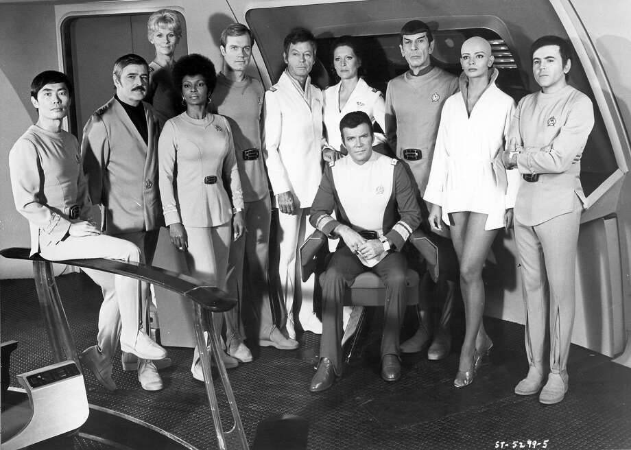 "DECEMBER 7:  Actors George Takei, James Doohan, Grace Lee Whitney, Nichelle Nichols, Stephen Collins, DeForest Kelley, Majel Barrett, William Shatner, Leonard Nimoy, Persis Khambatta, Walter Koenig pose for a portrait during the filming of the movie ""Star Trek: The Motion Picture"" which was released December 27, 1979 in the United States. (Photo by Michael Ochs Archives/Getty Images) Photo: Michael Ochs Archives"