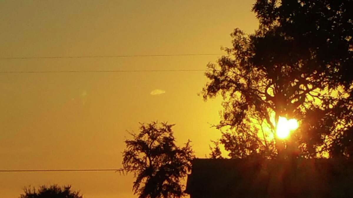 """""""A beekeeper was retrieving a bee trap at the Sienna Plantation near Sugar Land in Houston when they stopped to snap some quick photos of the sun setting. When they viewed the photos later, they noticed a strange dark cylindrical object in just one of the photos, implying the object must have been moving at a very fast rate."""" Reportedly seen on June 17, 2017 in Sugar LandSource: Texas UFO Sightings"""