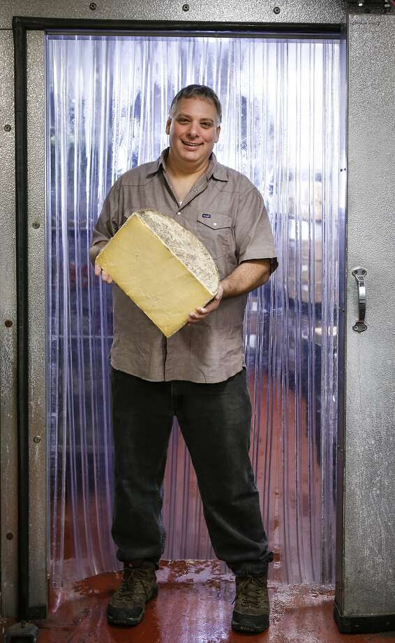 Gordon Edgar, the cheese buyer at Rainbow Grocery, seen on Thursday, Sept. 24, 2015 in San Francisco, Calif., is coming out with a new book about cheddar which is what he calls the iconic American cheese. Photo: Russell Yip, The Chronicle