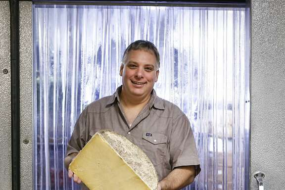 Gordon Edgar, the cheese buyer at Rainbow Grocery, seen on Thursday, Sept. 24, 2015 in San Francisco, Calif., is coming out with a new book about cheddar which is what he calls the iconic American cheese.