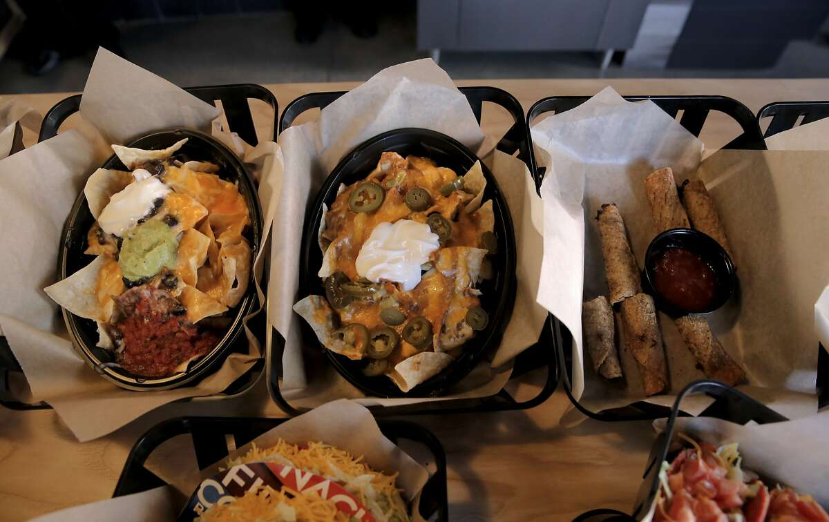 Taco Bell Cantina which is now open, in San Francisco, Calif., on the corner of 3rd St. and Townsend has menu items unique to the location, (l to r) Homestyle Nachos, Chili Cheese Nachos and Chicken or Beef Taquitos, as seen on Thurs. September 24, 2015.