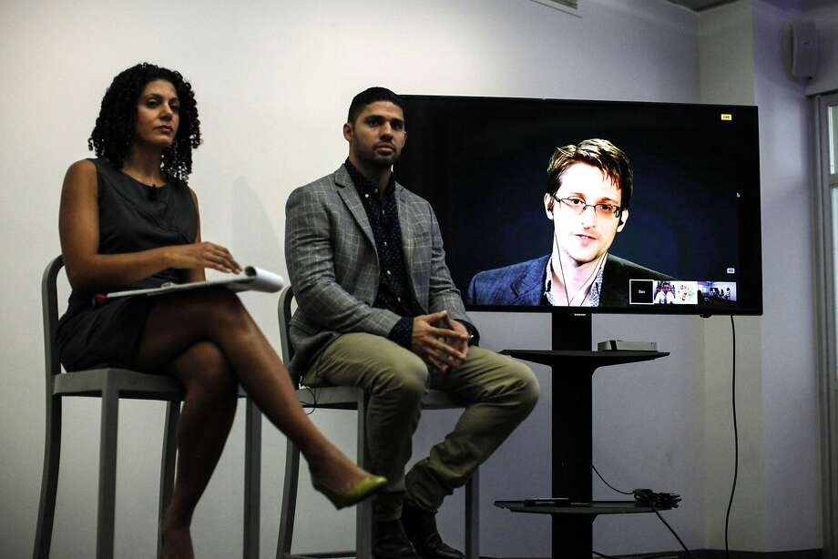"Via video link from Moscow, Edward Snowden told forum participants that improper surveillance is ""a global problem that affects all of us."" Photo: Kena Betancur, AFP / Getty Images"