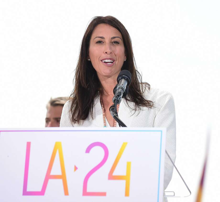 Former US Olympic Swimmer Janet Evans addresses the audience on a stage at the Annenberg Beach House in Santa Monica, California on September 1, 2015, after the Los Angeles City Council voted unanimously to go forward with a bid to host the 2024 Summer Olympic Games. Los Angeles joined the race to win the 2024 Olympics here Tuesday after city leaders gave unanimous backing for a bid to stage the sporting extravaganza for a third time. The United States Olympic Committee (USOC) formally named Los Angeles as its candidate soon after the city council members voted 15-0 in favour of supporting the bid. AFP PHOTO /FREDERIC J.BROWNFREDERIC J. BROWN/AFP/Getty Images Photo: Frederic J. Brown, AFP / Getty Images