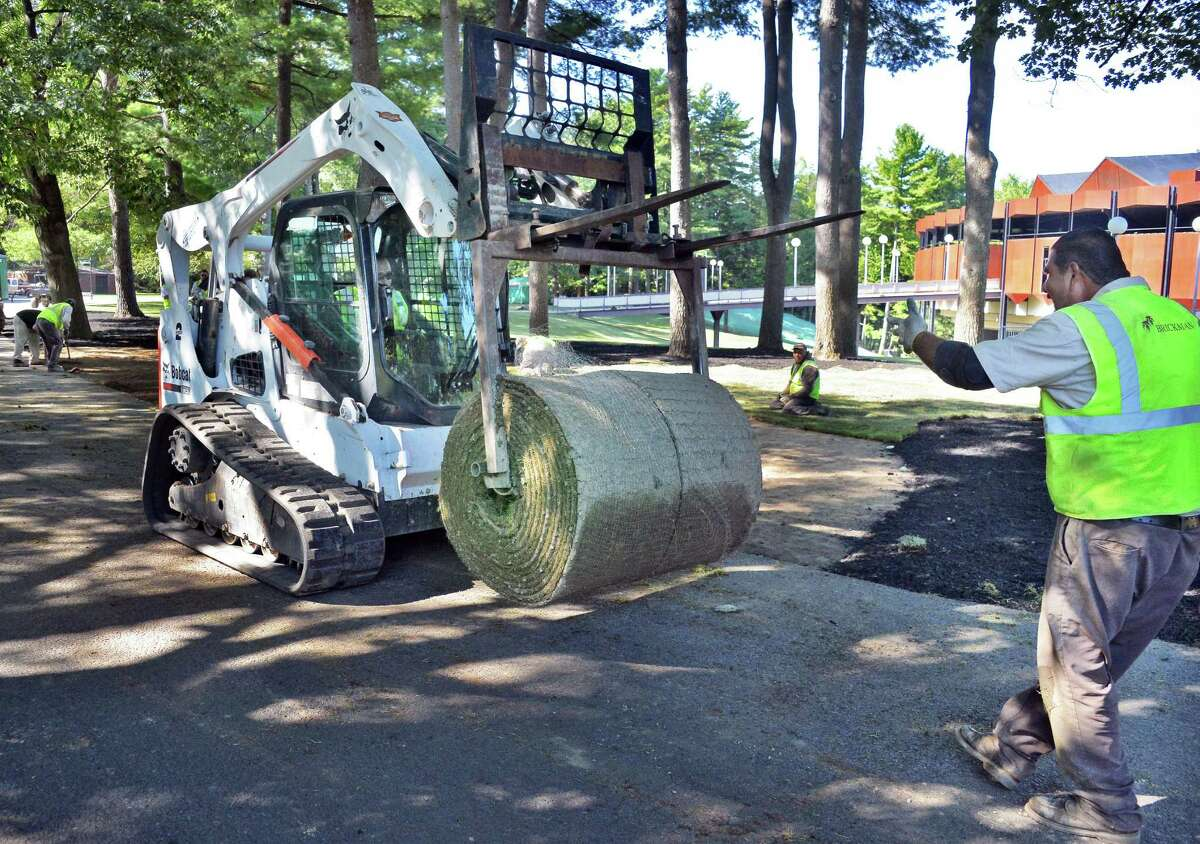 A crew from Brickman Landscaping in Schenectady resods the SPAC grounds Thursday Sept. 24, 2015 in Saratoga Springs, NY. (John Carl D'Annibale / Times Union)