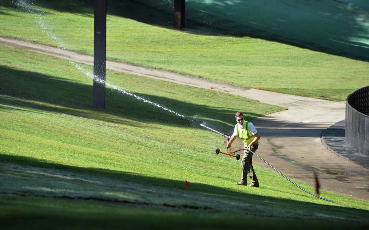 Erik Sossei of Brickman Landscaping in Schenectady waters new sod at the SPAC Thursday Sept. 24, 2015 in Saratoga Springs, NY. (John Carl D'Annibale / Times Union)