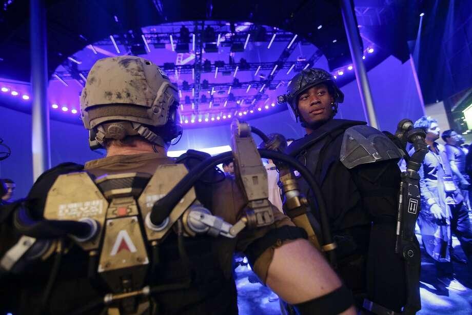 "Models dress as ""Call of Duty"" characters at 2014's E3. Photo: Jae C. Hong, Associated Press"