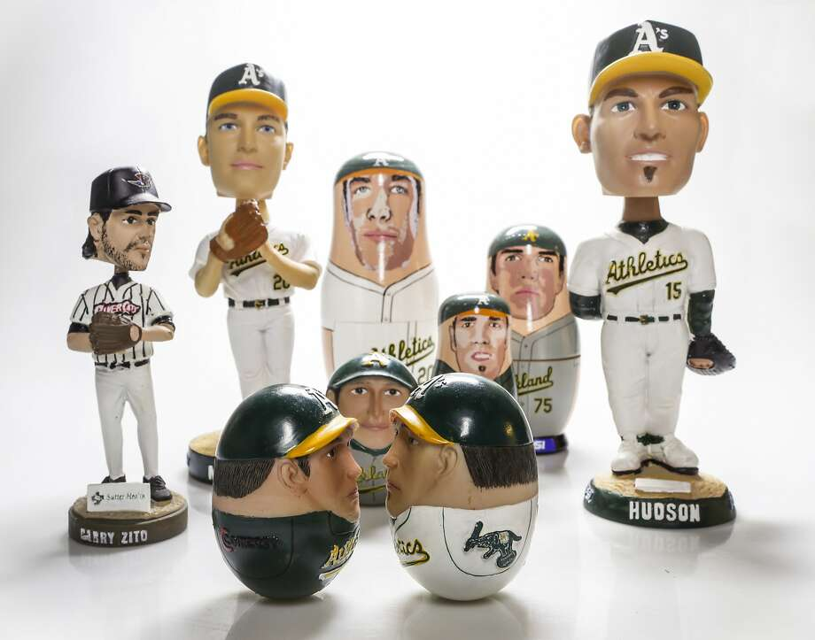 Bobble heads, wobble dolls and nesting dolls of Barry Zito, Tim Hudson and other Oakland A's. Photo: Russell Yip, The Chronicle